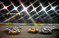 May 2, 2009; Richmond, VA, USA; (Editors Note: Special effects filter used in creation of this image) NASCAR Sprint Cup Series drivers Jeff Gordon (24), Sam Hornish Jr (77) and Mike Bliss (09) race three wide during the Russ Friedman 400 at the Richmond International Raceway. Mandatory Credit: Mark J. Rebilas-