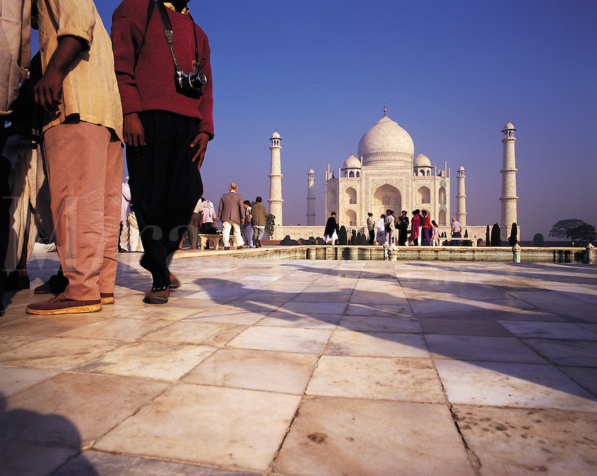 Low-angle view of the Taj Mahal with crowds of visitors, some in the foreground; Agra, Indi