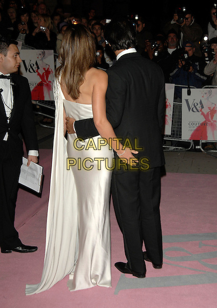 ELIZABETH HURLEY, ARUN NAYER.V&A Golden Age of Couture Gala.Victoria and Albert museum.18th September 2007 London, England.full length off the shoulder silk liz one hands around waist on bum back behind married couple husband wife.CAP/PL.©Phil Loftus/Capital Pictures