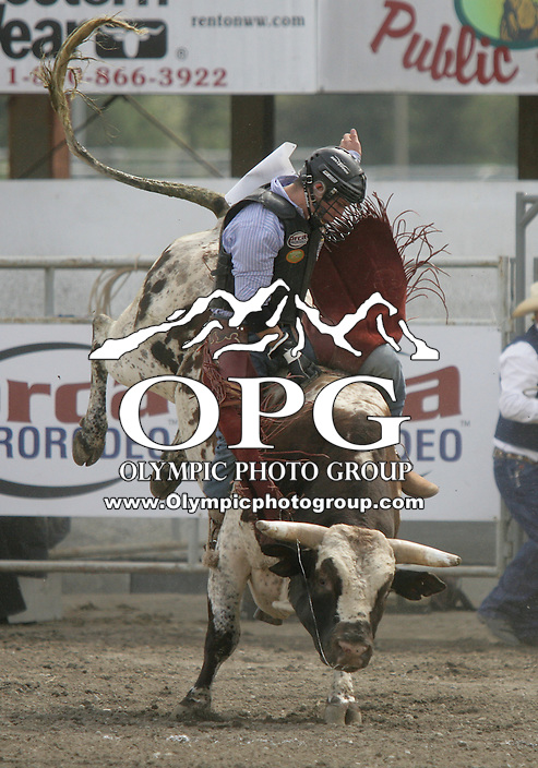 29 Aug 2010: Ryan Shanklin riding the bull Do You Wanna could not score during the first round of the Seminole Hard Rock Extreme Bulls competition at the Kitsap County Stampede in Bremerton, Washington.
