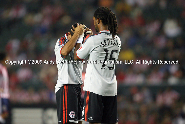 22 August 2009: Toronto's Amado Guevara (left) has his scalp checked by Adrian Serioux (15). CD Chivas USA played Toronto FC at the Home Depot Center in Carson, California in a regular season Major League Soccer game.