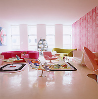 The living room of Karim Rashid's loft apartment is furnished with a variety of his own designs