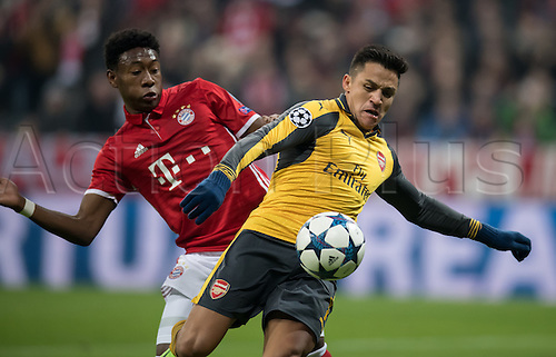 February 15th 2017, Munich, Germany;  Munich's David Alaba (l) and Arsenal striker Alexis Sanchez challenge for the ball in the first leg of the Champions League round of 16 tie between Bayern Munich and FC Arsenal in the Allianz Arena in Munich,
