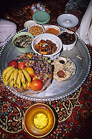 Mudayrib, Oman, Arabian Peninsula, Middle East - Lunch on the Eid al-Adha (Feast of the Sacrifice), the annual feast through which Muslims commemorate God's mercy in allowing Abraham to sacrifice a ram instead of his son, to prove his faith.   The main dish is arsi, or arsiya, a mixture of rice and meat, complemented by fruits, sweets, and dates.