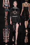 """Model walks runway in a black silk charmeuse fringe dress from the Reem Acra Fall 2016 """"The Secret World of The Femme Fatale"""" collection, at NYFW: The Shows Fall 2016, during New York Fashion Week Fall 2016."""