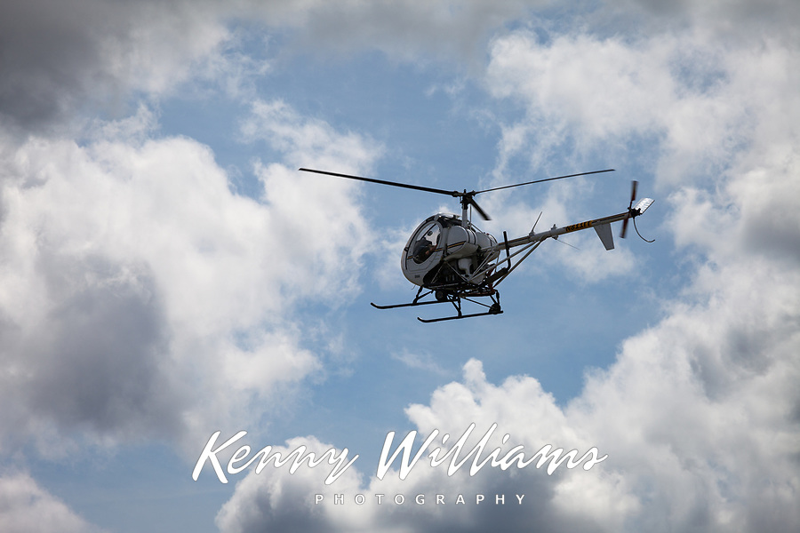 Helicopter flying through clouds, Arlington Fly-In 2016, Washington State, USA.