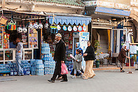 Essaouira, Morocco.  Family Walking, Avenue de l'Istiqlal.  Bottled Water and Soccer Balls for Sale.