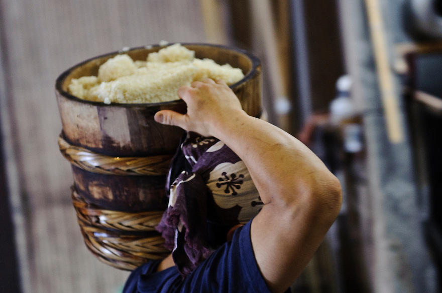 A worker carries a barrel of steamed rice, Terada Honke sake brewery, Kozaki, Chiba Prefecture, Japan, June 15, 2009. Terada Honke sake brewery has been brewing sake in the town of Ozaki since 1673. They make sake using organic rice, natural sake yeast, and traditional sake brewing methods.