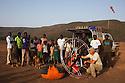 Kenya, Rift Valley, Lake Bogoria, many local people, mainly children watching me taking the paramotor apart