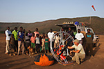 Kenya, Rift Valley, Lake Bogoria, many local people, mainly children watching me taking the paramotor apart
