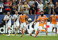 CARSON, CA - DECEMBER 01, 2012:   Todd Dunivant (2) of the Los Angeles Galaxy slides into a shot by Corey Ashe (26) of the Houston Dynamo during the 2012 MLS Cup at the Home Depot Center, in Carson, California on December 01, 2012. The Galaxy won 3-1.