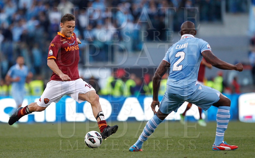 Calcio, finale di Coppa Italia: Roma vs Lazio. Roma, stadio Olimpico, 26 maggio 2013..AS Roma forward Francesco Totti, left, is challenged by Lazio defender Michael Ciani, of France, during the Italian Cup football final match between AS Roma and Lazio at Rome's Olympic stadium, 26 May 2013..UPDATE IMAGES PRESS/Isabella Bonotto....