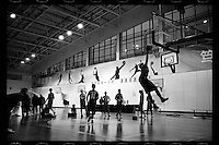 Basketball players of Huazhong Shida First Affiliated High School in Wuhan, Hubei province, attend a training session, December 2011.