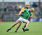 Darren O Connell of Limerick in action against Bradley Higgins of Clare during their Munster U-21 hurling quarter final at Cusack park. Photograph by John Kelly.