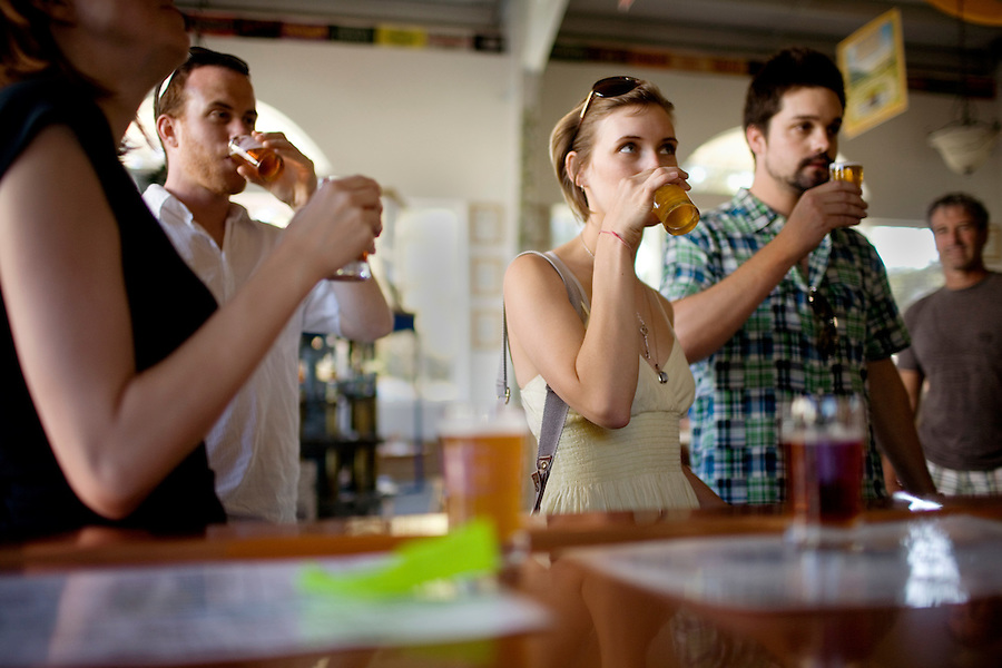 Tatiana Hantig, of Las Vegas, center, try samples of beer with Travis Landice, far right, Anastasia Henry and Bill Dowdle, at left, from San Francisco, at the Anderson Valley Brewing Company, in Boonville, Ca., on Sunday, Oct. 10, 2010.