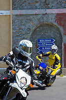 Motorcyclists on Honda Acerbis motorbikes drive The Stelvio Pass, Passo dello Stelvio, Stilfser Joch, to Bormio, Italy