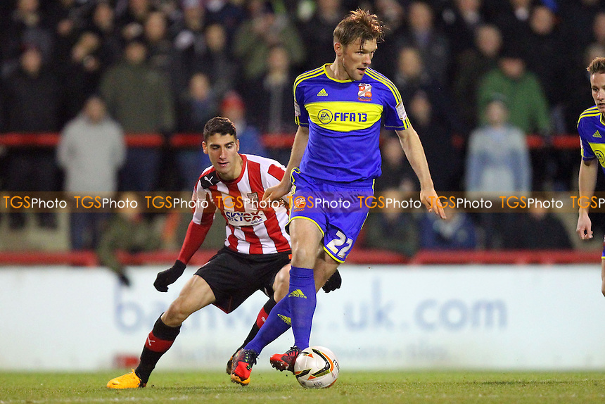 Darren Ward of Swindon Town evades Marcello Trotta of Brentford - Brentford vs Swindon Town - NPower League One Football at Griffin Park, London - 12/03/13 - MANDATORY CREDIT: Gavin Ellis/TGSPHOTO - Self billing applies where appropriate - 0845 094 6026 - contact@tgsphoto.co.uk - NO UNPAID USE.
