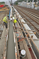 Concrete pouring of the platform footings. Construction Progress Photography of the Railroad Station at Fairfield Metro Center - Site visit 12 of once per month Chronological Documentation.