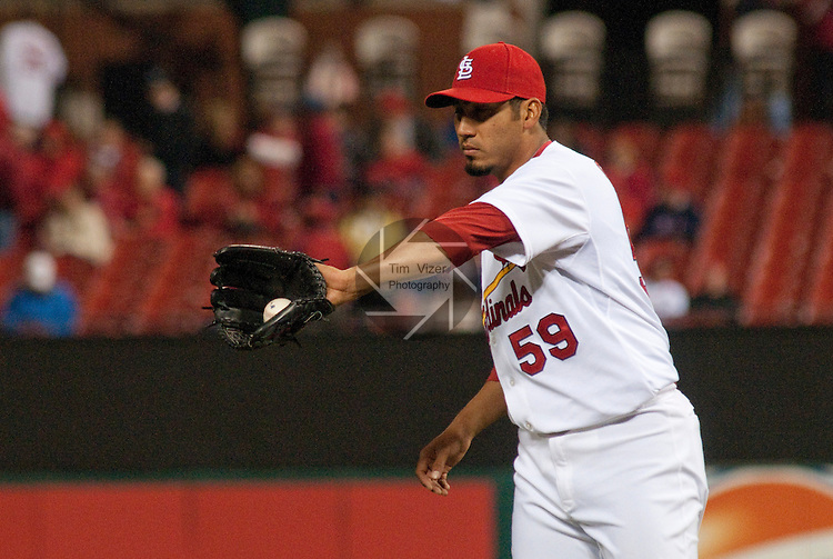 02 May 2011                                      St. Louis Cardinals relief pitcher Fernando Salas (59) catches the ball from the infield.  The Florida Marlins defeated the St. Louis Cardinals 6-5 on Monday May 2, 2011 in the first game of a four-game series at Busch Stadium in downtown St. Louis.