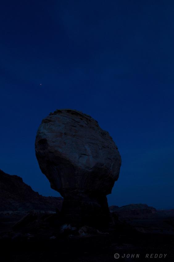 sillouhette of Twin Rock against blue night sky