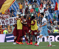 Calcio, Serie A: Lazio vs Roma. Roma, stadio Olimpico, 25 maggio 2015.<br /> Roma's Mapou Yanga-Mbiwa, center, celebrates with teammates as Lazio's Marco Parolo, right, leaves the pitch at the end of the Italian Serie A football match between Lazio and Roma at Rome's Olympic stadium, 25 May 2015. Roma won 2-1.<br /> UPDATE IMAGES PRESS/Isabella Bonotto