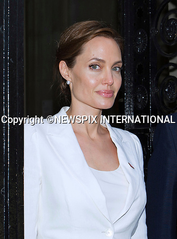 10.06.2014, LONDON: ANGELINA JOLIE VISITS N0.10 DOWNING STREET<br /> ahead of the start of the End Sexual Violence In Conflict Summit in London.<br /> Jolie met with Britsh Prime Minister David Cameron at No.10<br /> Miss Jolie together William Hague is chairing the summit being held at the Excel, London<br /> Mandatory Photo Credit: Dias/NEWSPIX INTERNATIONAL<br /> <br /> **ALL FEES PAYABLE TO: &quot;NEWSPIX INTERNATIONAL&quot;**<br /> <br /> PHOTO CREDIT MANDATORY!!: NEWSPIX INTERNATIONAL(Failure to credit will incur a surcharge of 100% of reproduction fees)<br /> <br /> IMMEDIATE CONFIRMATION OF USAGE REQUIRED:<br /> Newspix International, 31 Chinnery Hill, Bishop's Stortford, ENGLAND CM23 3PS<br /> Tel:+441279 324672  ; Fax: +441279656877<br /> Mobile:  0777568 1153<br /> e-mail: info@newspixinternational.co.uk