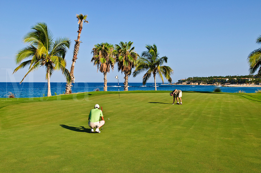 Golfers on green, Palmilla Golf Course, San Jose del Cabo, Baja California Sur, Mexico
