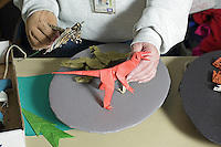 OrigamiUSA artists preparing the models and designing the Holiday Tree at the American Museum of Natural History. Ros Joyce hands at work.
