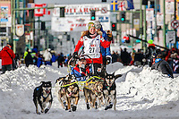 Sigrid Ekran runs down 4th avenue during the Ceremonial Start of the 2016 Iditarod in Anchorage, Alaska.  March 05, 2016