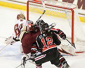 Kelli Stack (BC - 16), Stephanie Gavronsky (NU - 44), Sonia St. Martin (NU - 12) - The Boston College Eagles defeated the visiting Northeastern University Huskies 2-1 on Sunday, January 30, 2011, at Conte Forum in Chestnut Hill, Massachusetts.
