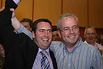 Damien English, Fine Gael who took the final seat in Meath West after the 7th count with Peter Higgins, Fine Gael who was eliminated after the 6th count at The Counting Station, Navan...Photo NEWSFILE/Jenny Matthews.(Photo credit should read Jenny Matthews/NEWSFILE)....This Picture has been sent you under the condtions enclosed by:.Newsfile Ltd..The Studio,.Millmount Abbey,.Drogheda,.Co Meath..Ireland..Tel: +353(0)41-9871240.Fax: +353(0)41-9871260.GSM: +353(0)86-2500958.email: pictures@newsfile.ie.www.newsfile.ie.FTP: 193.120.102.198.