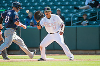 Efren Navarro (14) of the Salt Lake Bees on defense against the Reno Aces in Pacific Coast League action at Smith's Ballpark on May 10, 2015 in Salt Lake City, Utah.  Reno defeated Salt Lake 11-2 in Game Two of the double-header. (Stephen Smith/Four Seam Images)