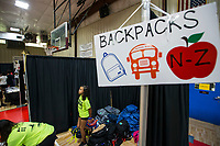 NWA Democrat-Gazette/BEN GOFF @NWABENGOFF<br />  Saturday, Aug. 10, 2019, during the Northwest Arkansas Community Back to School Extravaganza at the Yvonne Richardson Community Center in Fayetteville. Four area churches; St. James Missionary Baptist Church, Good Shepherd Lutheran Church, Agape Ministries and New Heights, partnered to put on the event. Community partners provided free vision and dental screenings, haircuts, blood pressure checks for parents and backpacks full of school supplies.