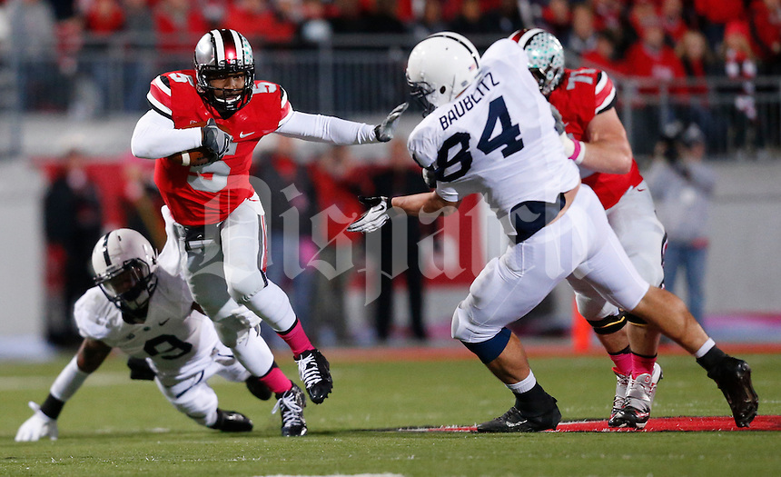 Ohio State Buckeyes quarterback Braxton Miller (5) dodges a tackle by Penn State Nittany Lions cornerback Jordan Lucas (9) as Ohio State Buckeyes offensive linesman Corey Linsley (71) blocks Penn State Nittany Lions defensive tackle Kyle Baublitz (84) during Saturday's NCAA Division I football game at Ohio Stadium on October 26, 2013. (Barbara J. Perenic/The Columbus Dispatch)