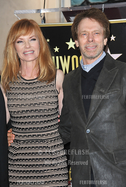 Marg Helgenberger, star of TV series CSI: Crime Scene Investigation, with producer Jerry Bruckheimer on Hollywood Boulevard where she is honored with the 2,458th star on the Hollywood Walk of Fame..January 23, 2012  Los Angeles, CA.Picture: Paul Smith / Featureflash