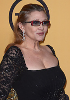 27 December 2016 - Carrie Fisher, the iconic actress who portrayed Princess Leia in the Star Wars series, died Tuesday following a massive heart attack. Carrie Frances Fisher an American actress, screenwriter, author, producer, and speaker, was the daughter of singer Eddie Fisher and actress Debbie Reynolds. File Photo: 25 January 2015 - Los Angeles, California - Carrie Fisher. 21st Annual SAG Awards Press Room held at the Los Angeles Shrine Exposition Center. Photo Credit: Birdie Thompson/AdMedia