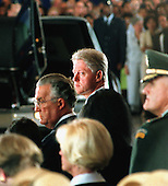 United States President Bill Clinton watches as the caskets of the US Embassy personnel lost in Africa are brought to the Memorial Service held in a hanger at Andrews Air Force Base in Maryland on August 13, 1998.  <br /> Credit: Ron Sachs / CNP