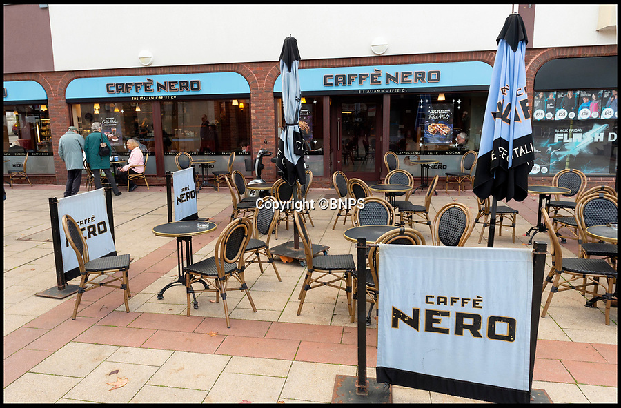 BNPS.co.uk (01202 558833)<br /> Pic:  RogerArbon/BNPS<br /> <br /> Caffe Nero.<br /> <br /> A retirement town that is overspilling with coffee shops is to get its 15th after officials lost their bid to put a lid on them.<br /> <br /> Councillors in Christchurch, Dorset, refused a Coffee#1 permission to take over an empty shop because the town had too many cafes.<br /> <br /> But the national chain appealed the decision and have won their case.<br /> <br /> It means there will now be 15 coffee shops in a 500 metre stretch of the High Street - or one every 33 metres.