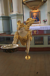 Golden angel figure inside historic Nykirken church, city of Bergen, Norway