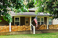 House in Joseph Oregon with firewood stacked on porch.