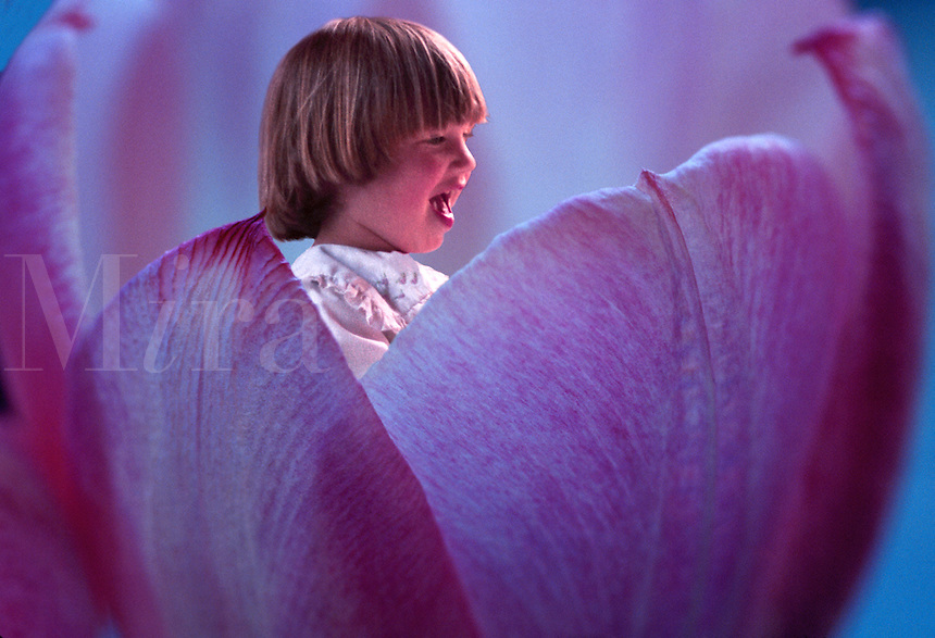 A flower child laughing in a tulip.