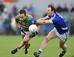 Peter O Dwyer of  Kilmurry Ibrickane in action against Barry Duggan of Cratloe during their senior football final replay at Cusack park. Photograph by John Kelly.