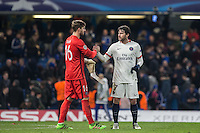 Goalkeeper Kevin Trapp of Paris Saint-Germain & Maxwell of Paris Saint-Germain on the final whistle during the UEFA Champions League Round of 16 2nd leg match between Chelsea and PSG at Stamford Bridge, London, England on 9 March 2016. Photo by Andy Rowland.