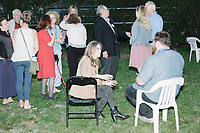 Democratic presidential candidate and spiritual guru Marianne Williamson speaks with Keene Sentinel reporter Jake Lahut after speaking to a small crowd in the back yard of Kathleen O'Donnell at a campaign house party event in Keene, New Hampshire, on Wed., May 22, 2019.