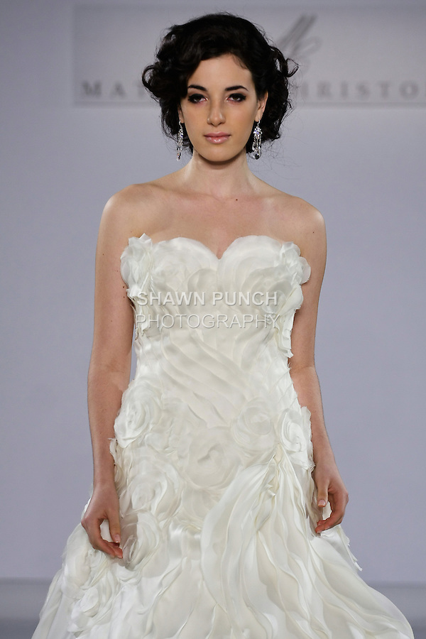 Model walks runway in a Gardenia wedding dress from the Matthew Christopher Couture Spring 2013 collection, at the Couture Show, during New York Bridal Fashion Week Spring 2013.