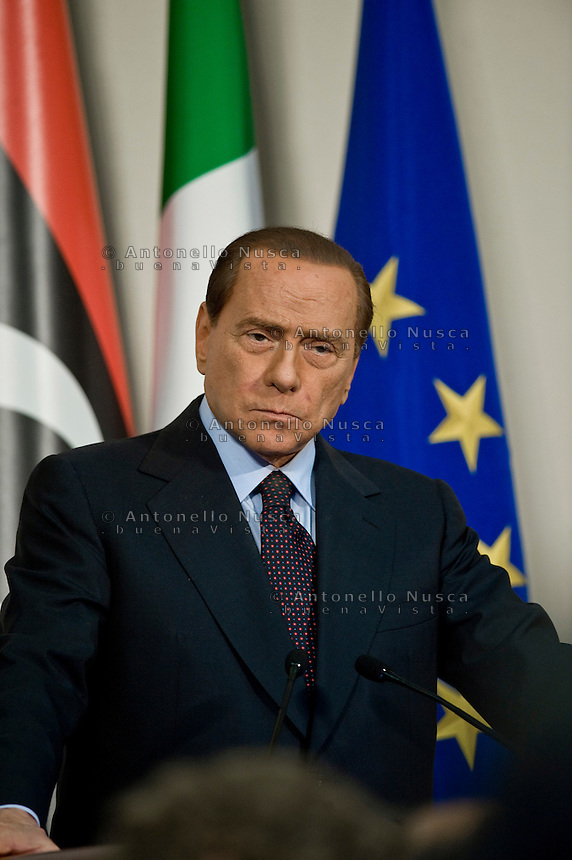 Italian Prime Minister Silvio Berlusconi attends a meeting with the Deputy chairman of the National Transitional Council Executive Board Mahmoud Jibril at the Prefecture Palace in Milan, Italy to discuss the future of Libya in the wake of the collapse of Muammar Qaddafi's regime and discuss an Italian aid plan..Silvio Berlusconi durante il suo intervento nella Prefettura di Milano dopo l'incontro con il  primo ministro del Consiglio nazionale transitorio libico Mahmoud Jibril