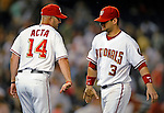 11 July 2008: Washington Nationals' Manager Manny Acta slaps a low five with catcher Jesus Flores (right) after the winning out is recorded against the Houston Astros at Nationals Park in Washington, DC. The Nationals shut out the Astros 10-0 in the first game of their 3-game series...Mandatory Photo Credit: Ed Wolfstein Photo