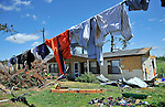 Damage from tornado Wednesday April 27, 2011 in the Harvest area. Tiffany and Kevin Moss at 420 Yarbrough Rd. use downed power line to dry their wet clothing.   (The Huntsville TImes/Bob Gathany)