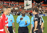 Carey Talley #8 of D.C. United and Daniel Hernandez #2 of FC Dallas watch the coin toss by referee Abiodun Okulaja during an MLS match at RFK Stadium in Washington D.C. on August 14 2010. Dallas won 3-1.