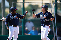 Atlanta Braves Justin Smith (left) fist bumps Austin Bush (right) after a home run during an Instructional League game against the Detroit Tigers on October 10, 2017 at the ESPN Wide World of Sports Complex in Orlando, Florida.  (Mike Janes/Four Seam Images)